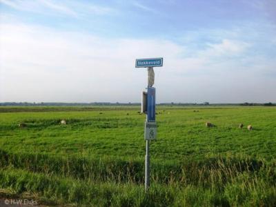 Nekkeveld (buurtschap van Nijkerk) heeft geen plaatsnaambordjes. Gelukkig kun je aan de gelijknamige straatnaambordjes nog zien dat je in de buurtschap bent aanbeland.