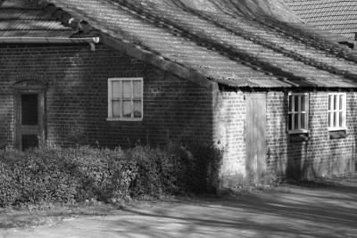 Detail van een van de oude boerderijen in de buurtschap Berkeind die in 2016 is afgebroken om ruimte te maken voor bedrijventerrein Wijkevoort. Dit was de tweede boerderij aan de Schoorweg aan de rechterkant. (© Martijn de Rooij, Tilburg)