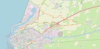 Het dorp Midlum (binnen de oranje lijn) ligt direct NO van de stad Harlingen, direct aan afslag 19 van de A31, en grenst in het N aan het dorp Wijnaldum en in het O aan het dorp Herbaijum. (© www.openstreetmap.org)
