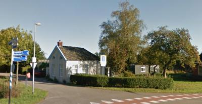 Het voormalige tolhuisje op de kruising Euvelgunnerweg / Olgerweg in buurtschap Oude Roodehaan is een monument en was tot 1942 in bedrijf. (© Google)