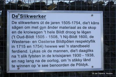 Zwarte Haan, informatiepaneel in het Bildts over de slikwerkers die vanaf 1505 tot 1754 het hele gebied van Het Bildt met schop en kruiwagen hebben ingepolderd en ook in 1930-1938 nog land hebben gewonnen op de zee.