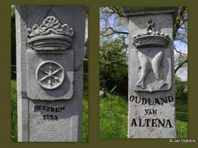 Oude grenspalen die de grens aangeven tussen de vroegere streken Land van Heusden en Land van Altena, aan de Maasdijk tussen de dorpen Veen en Andel
