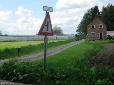 De buurtschap rond de Liesstraat W van Breda heet volgens de bordjes Lies, maar de inwoners houden het liever op Liesbos